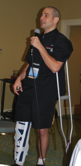 Paul delivering speach on crutches
